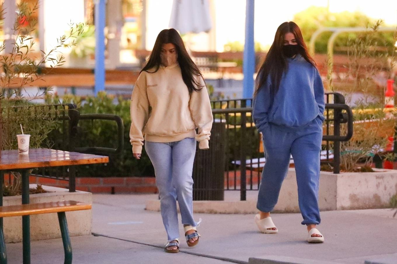 Kourtney Kardashian, cream  sweatshirt, oversized, Pangaia  sweatshirt, light blue jeans, silver Rick Owens flats, hip length, extra long sleeves, crew neck, casual, ribbed trim hem