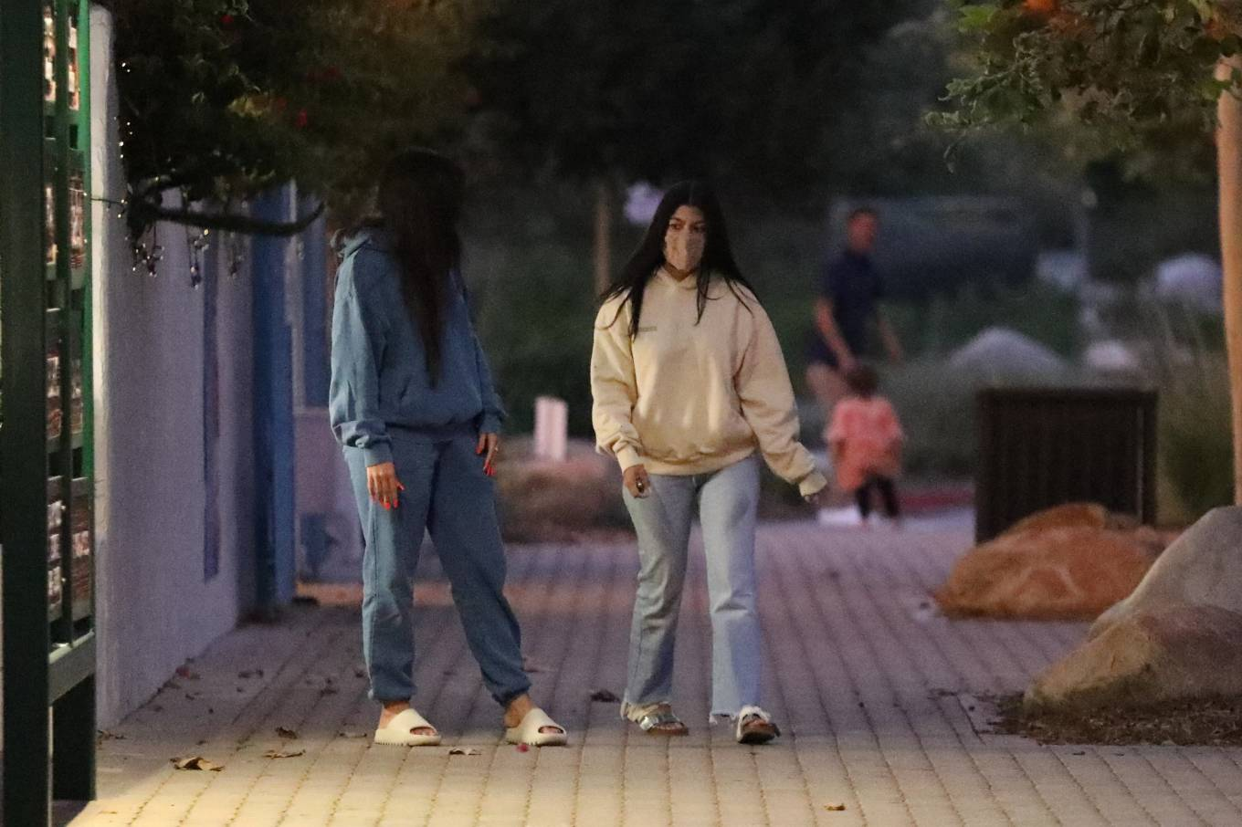 Kourtney Kardashian, cream  sweatshirt, oversized, Pangaia  sweatshirt, silver Rick Owens flats, light blue jeans, hip length, extra long sleeves, crew neck, casual, ribbed trim hem