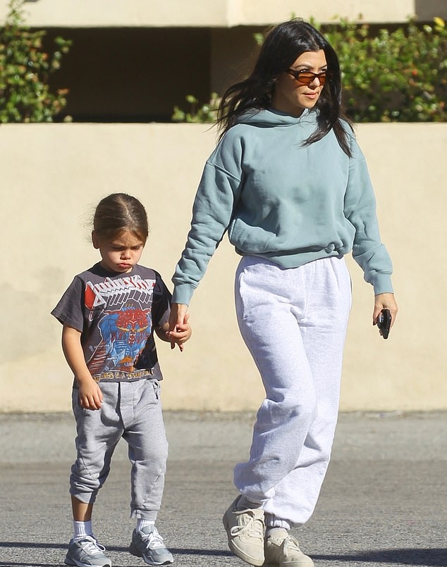 Kourtney Kardashian donning white Adidas lace-up sneakers