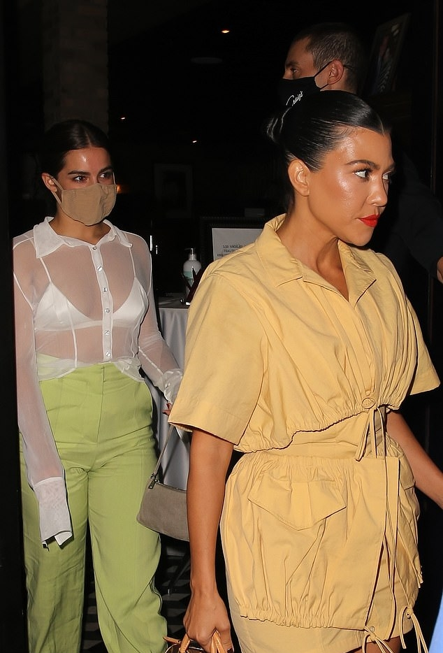 Kourtney Kardashian wearing strappy Nude sandals with high heel and thin straps