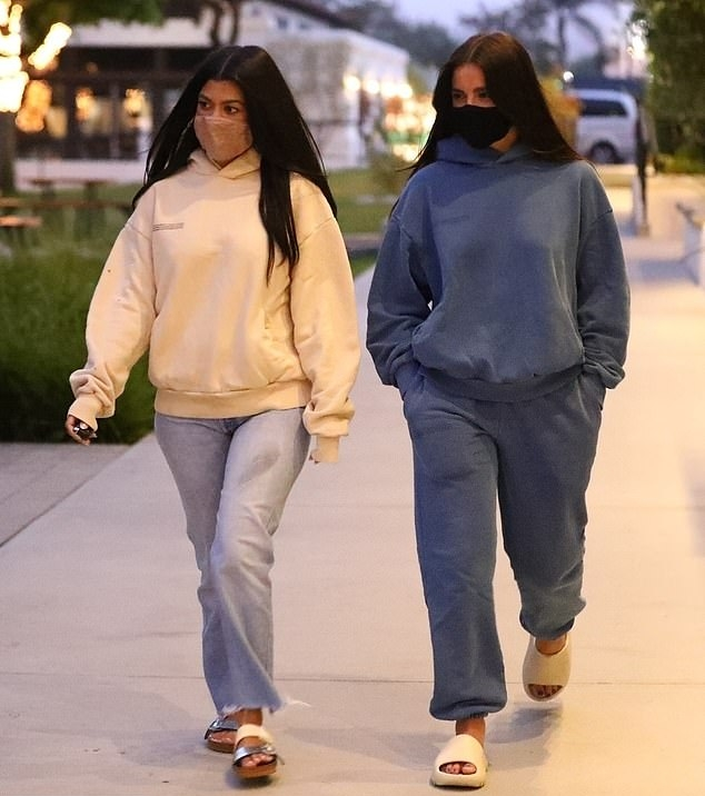 Kourtney Kardashian, Pangaia  sweatshirt, cream  sweatshirt, oversized, light blue jeans, silver Rick Owens flats, crew neck, casual, hip length, extra long sleeves, ribbed trim hem