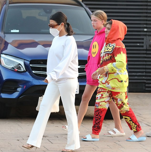 Kourtney Kardashian donning completely see-through white mules with high heel