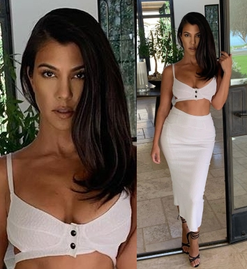 Kourtney Kardashian wearing a Plunging white Olivier Theyskens crop top with thin shoulder strap, cut out and a V-neck