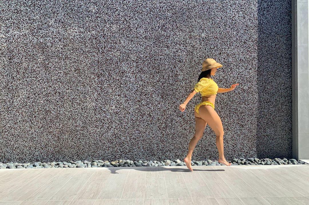 Kourtney Kardashian wearing Yellow bikini bottom