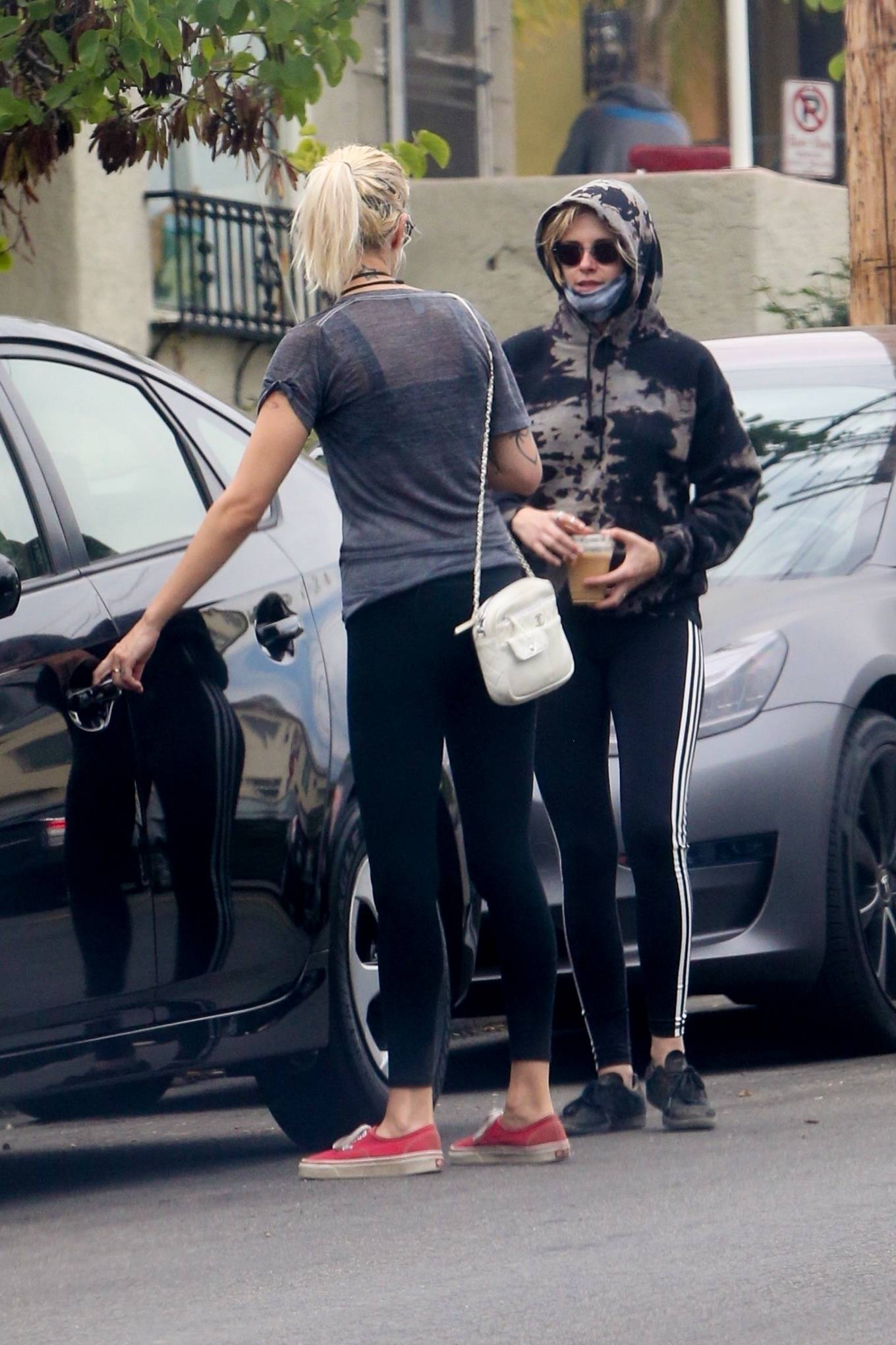 Kristen Stewart rocking skinny black white side striped ankle length leggings by Adidas