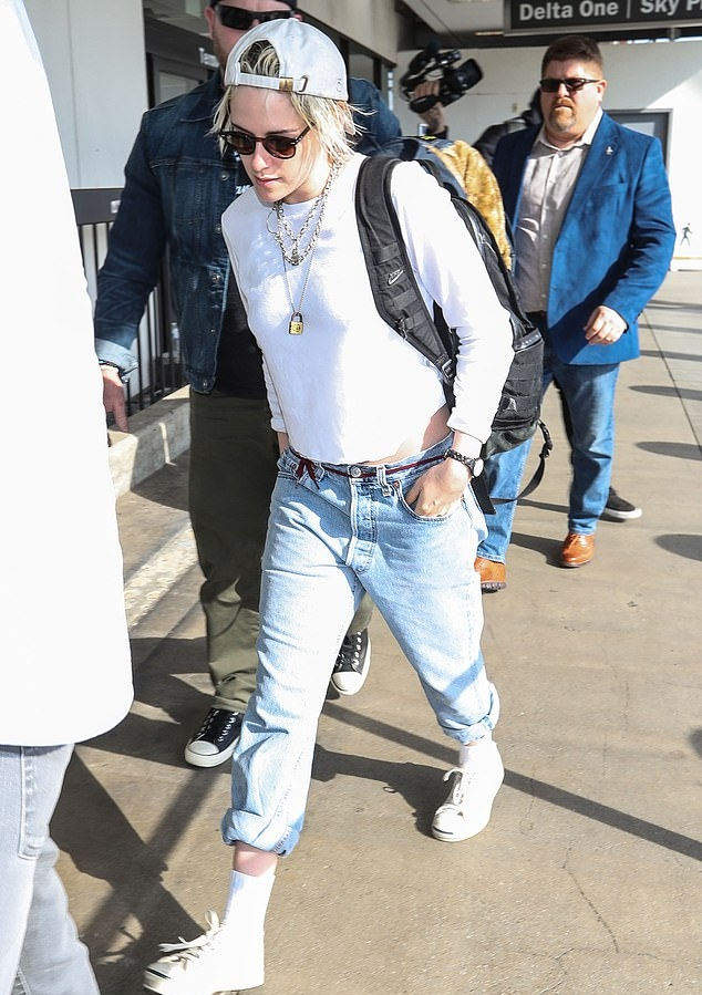 Kristen Stewart rocking off white leather lace-up sneakers