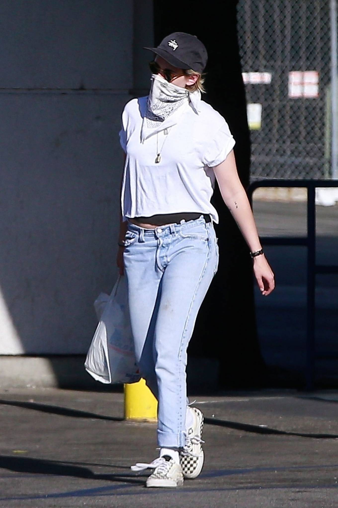 Kristen Stewart rocking a white basic tee with short sleeves and a crew neck