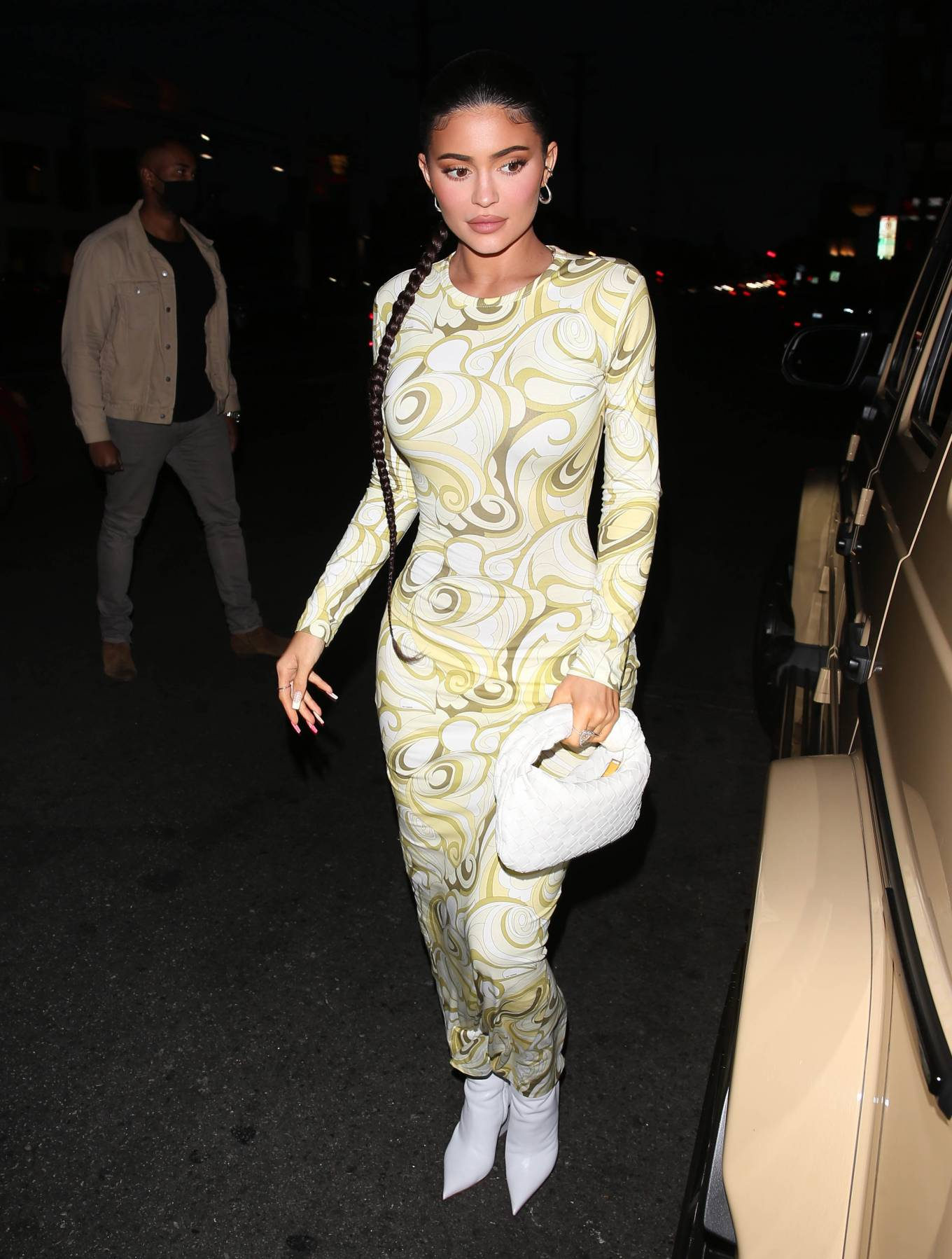 Kylie Jenner donning a figure hugging yellow dress which showed off her hour glass figure while going to have dinner at Nobu in West Hollywood