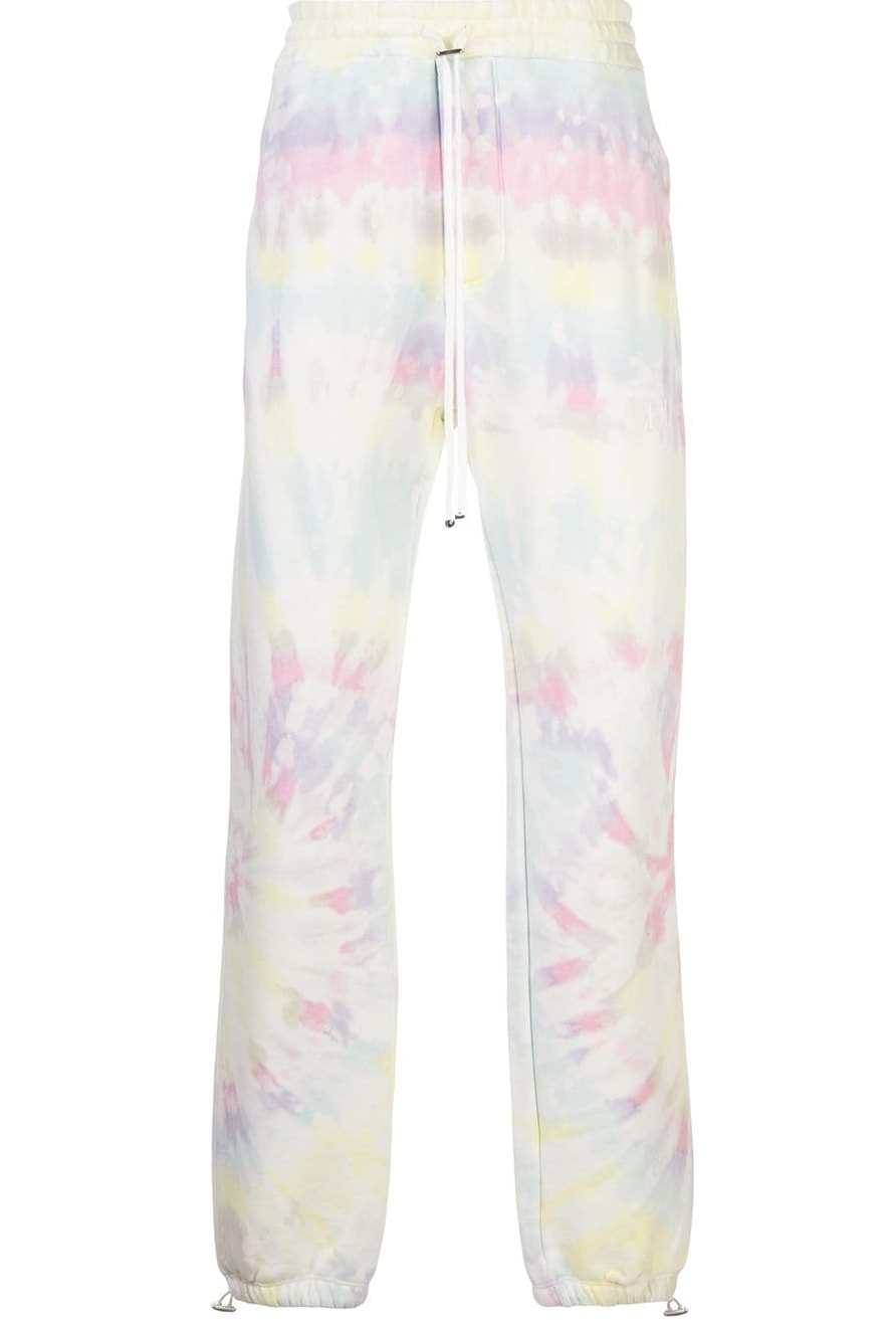 Kylie Jenner wearing comfortable white yellow pink tie dye joggers with drawstring hem