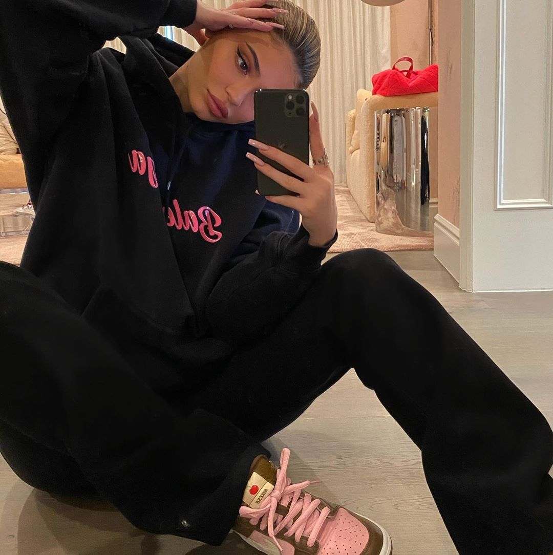 Kylie Jenner rocking brand logo pink Nike lace-up sneakers