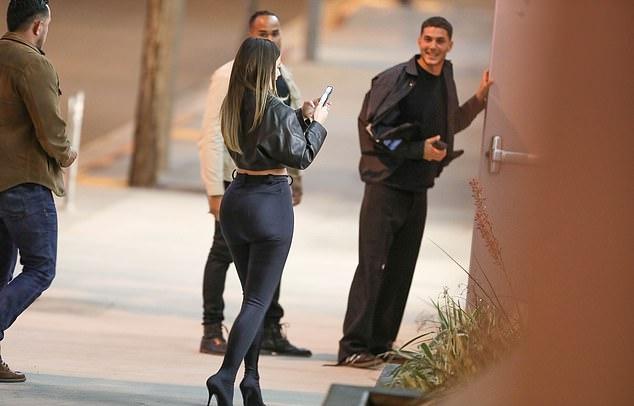 Kylie Jenner wearing Black Balenciaga pantashoes pants
