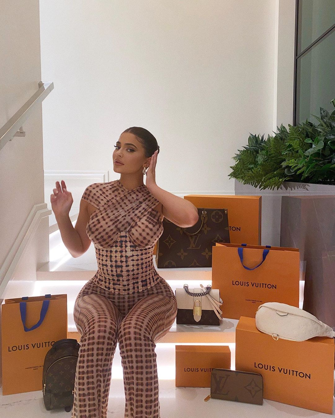 Kylie Jenner wearing Beige checks trousers Charlotte Knowles with high rise