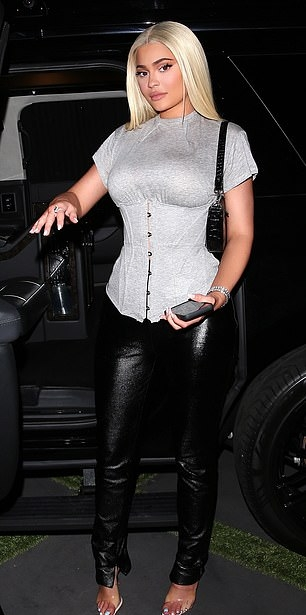 Kylie Jenner donning High rise black leather jeans by designer Danielle Guizio with zip pockets and a leather fabric