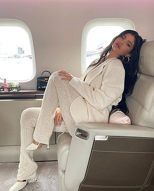 Kylie Jenner wearing skinny cream crochet high waist flare pants with a cotton material