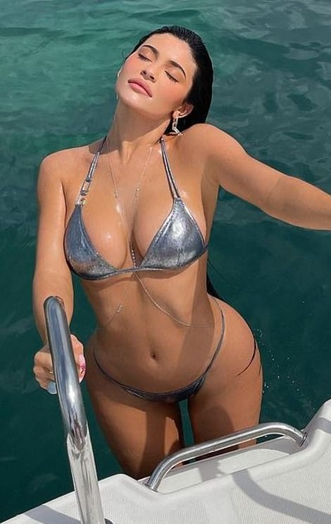 Kylie Jenner rocking a plunging Dolce & Gabbana bikini top with embellished, a halter neck and two ties at the shoulder