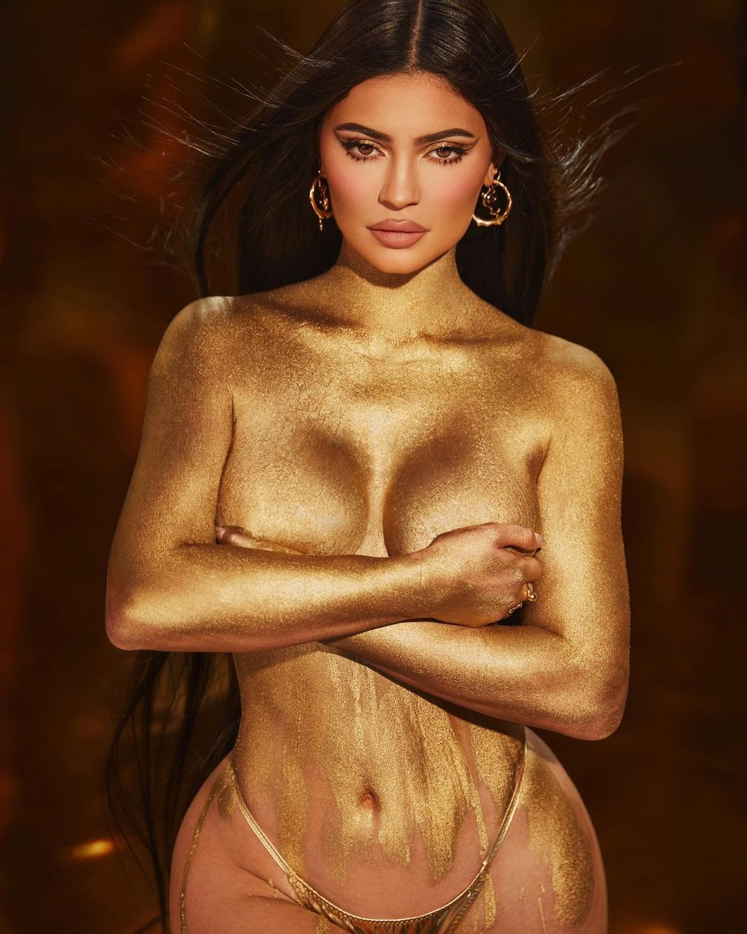 Kylie Jenner rocking metallic gold thong while posing for her 24th Birthday on Instagram