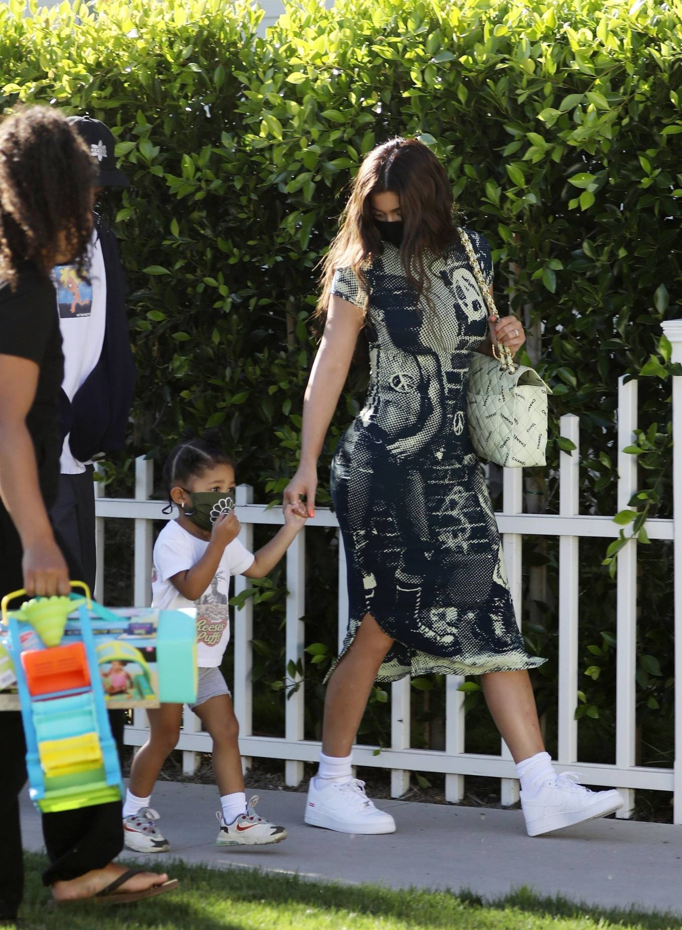 Kylie Jenner donning round white Nike lace-up sneakers
