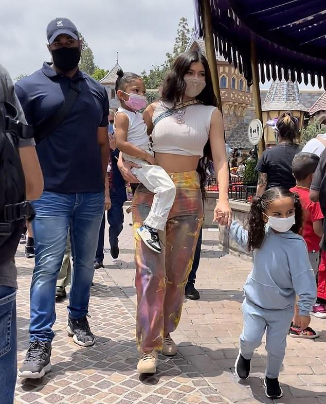 Kylie Jenner wearing round beige Jordan lace-up sneakers
