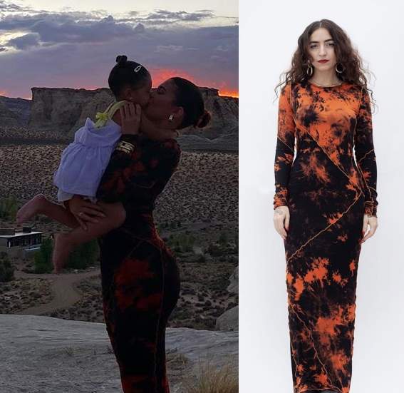 Kylie Jenner donning a Figure hugging black Kim Shui orange tie dye maxi dress with full sleeves and a crew neck
