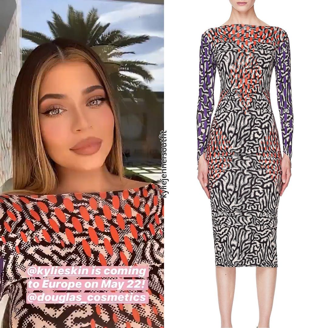 Kylie Jenner wearing a Figure hugging vibrant beige Maisie Wilen midi dress with contrast full sleeves with purple print and a boat neck