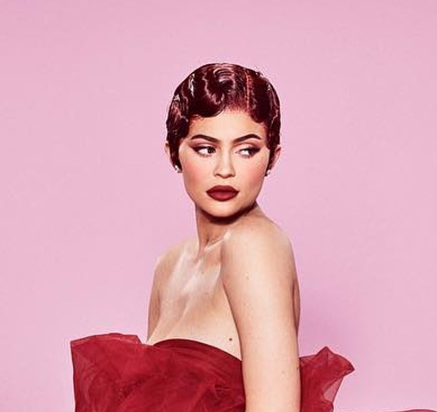 Kylie Jenner rocking a sheer bright red gown with a mesh detailing material and flared hem