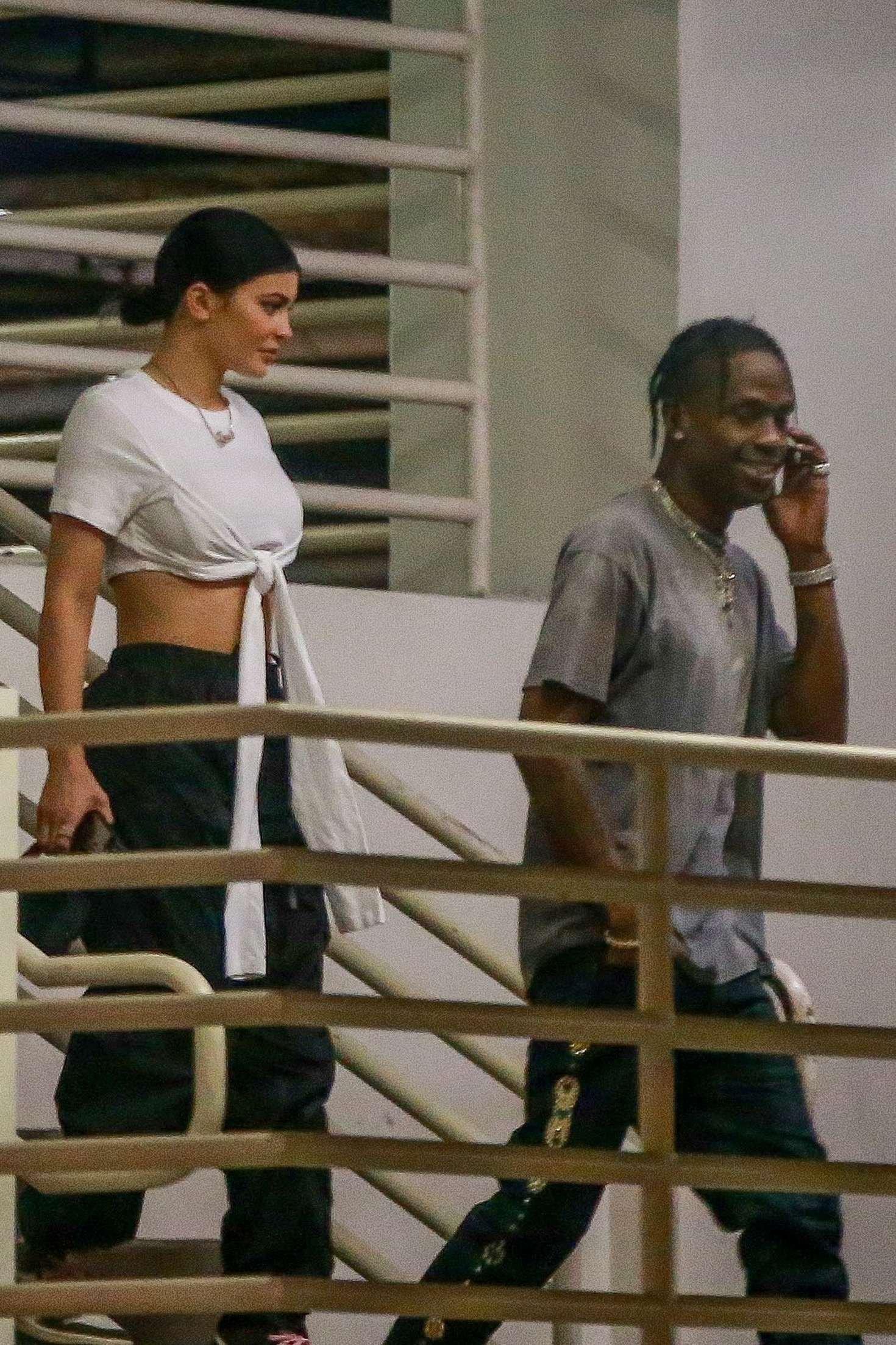 Kylie Jenner wearing black baggy sweatpants