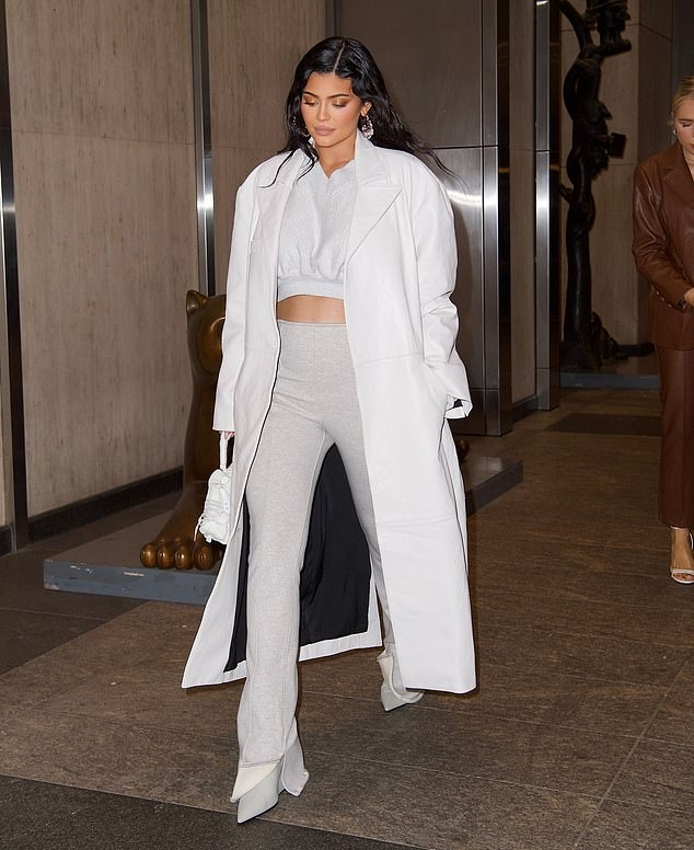 Kylie Jenner rocking pointed white leather zip up boots by Off-White with wedge heel