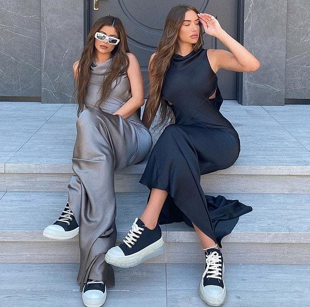 Kylie Jenner rocking a Shiny grey Rick Owens satin maxi dress with a satin fabric, cut out and a cowl neck