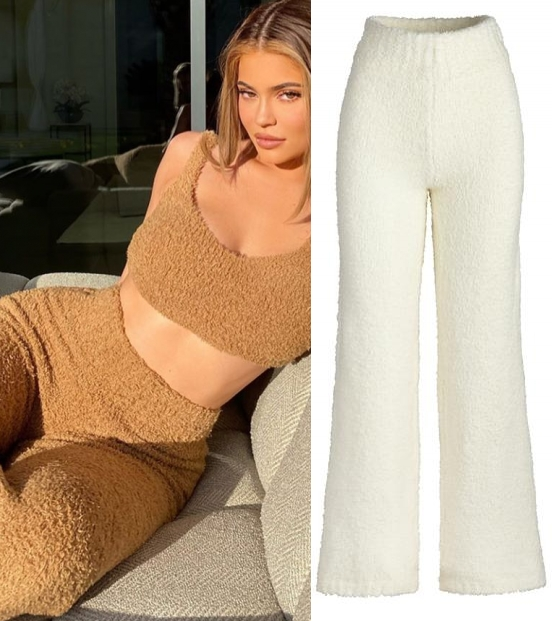 Kylie Jenner wearing a Plunging brown Skims crop top with cozy knit, soft, stretchy fluffy boucle yarn and a round neck
