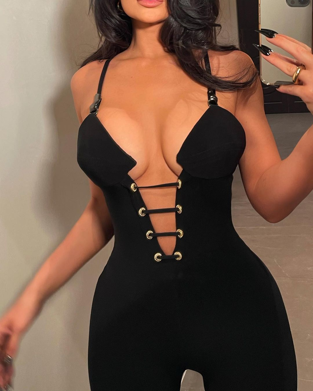 Kylie Jenner donning a figure hugging Versace jumpsuit with a nylon material, spaghetti straps and plunging neckline that almost went down to her waist