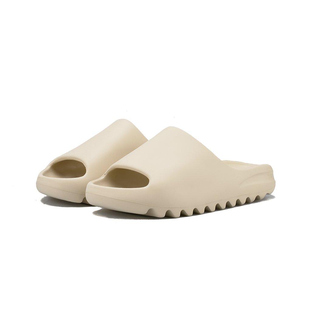 Kylie Jenner rocking chunky bone Yeezy open toe slippers