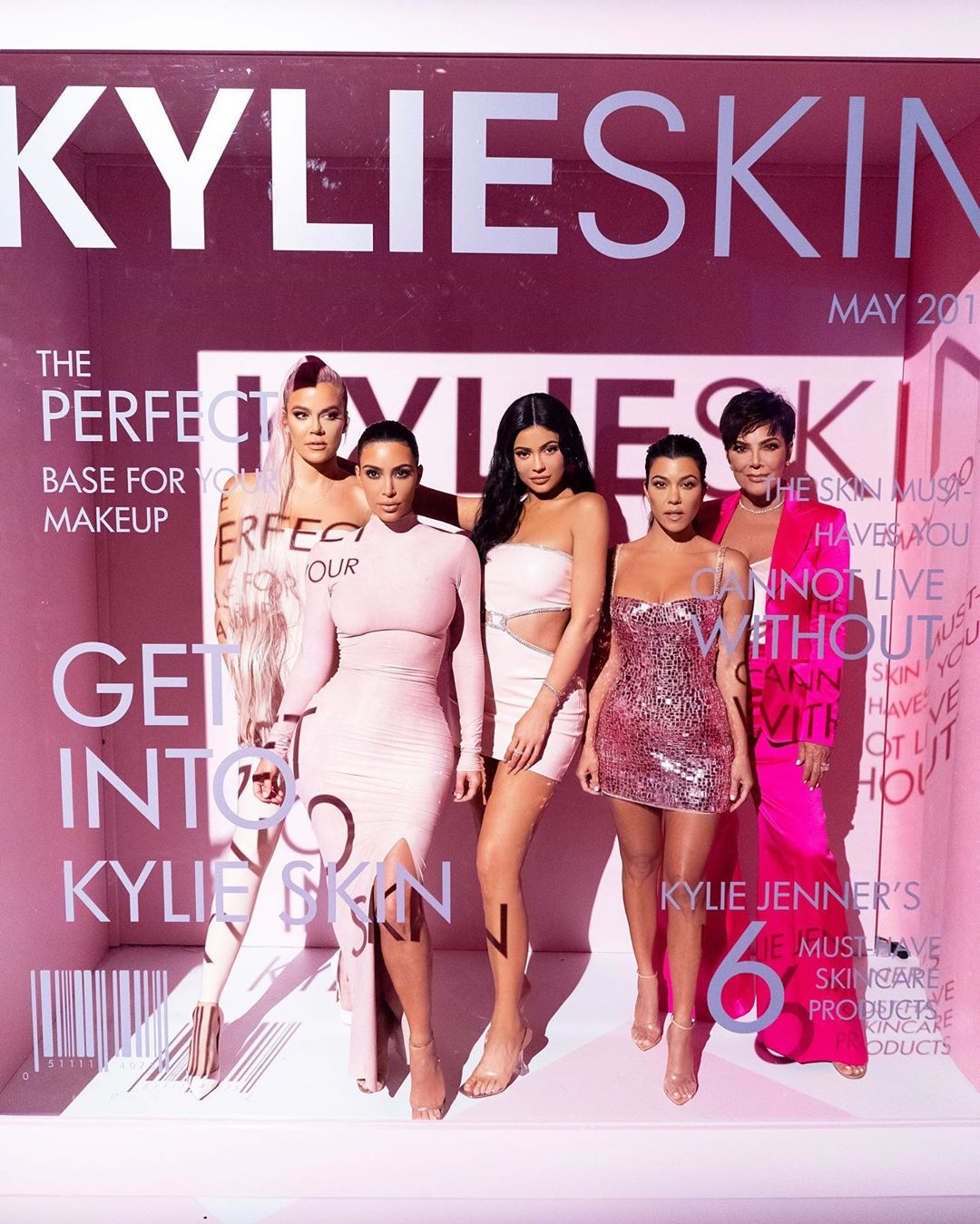 Kylie Jenner donning transparent open toe mules with high heel and PVC-strap