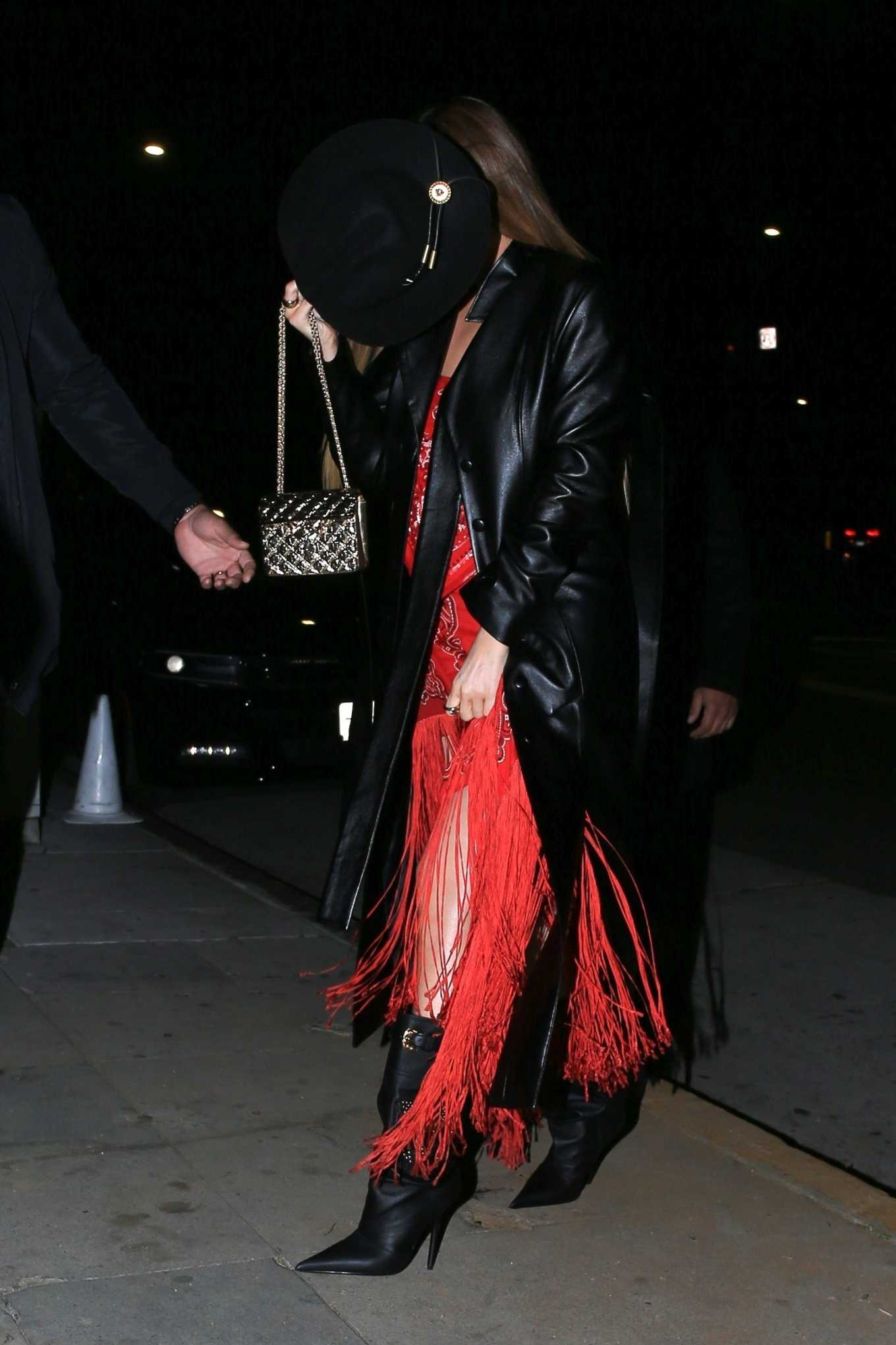 Kylie Jenner rocking a Plunging red two piece separates dress with asymmetric design and fringed hem