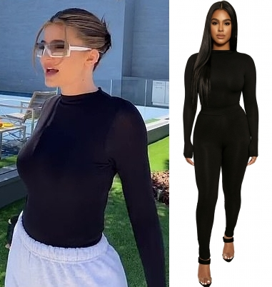 Kylie Jenner rocking a Figure hugging black Naked Wardrobe bodysuit with a spandex material, extra long sleeves and a crew neck