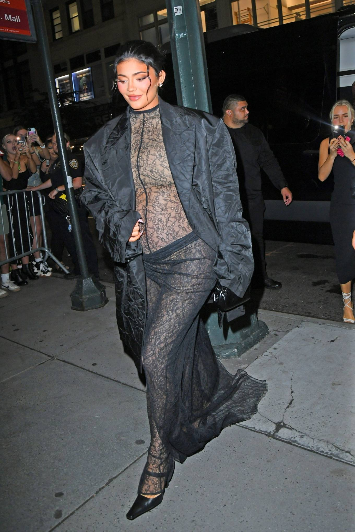 Kylie Jenner rocking a oversized black blazer with extra long sleeves, lapel collar and crushed material detailing