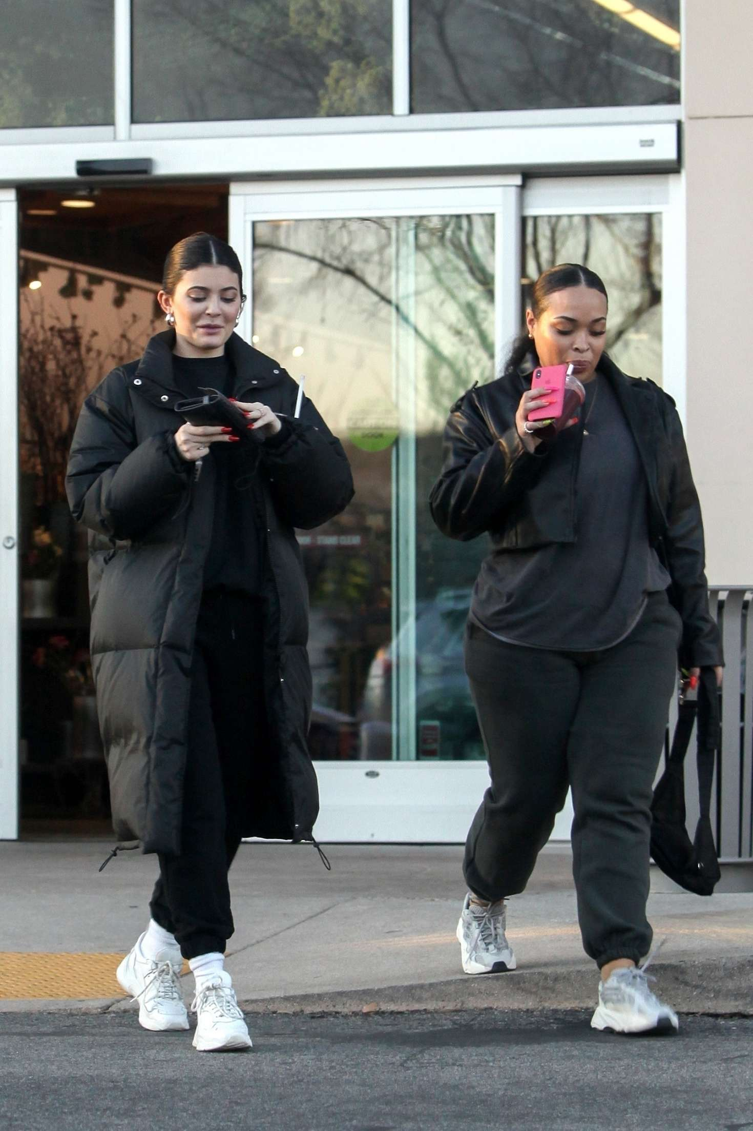 Kylie Jenner wearing a baggy black sweatshirt with a crew neck