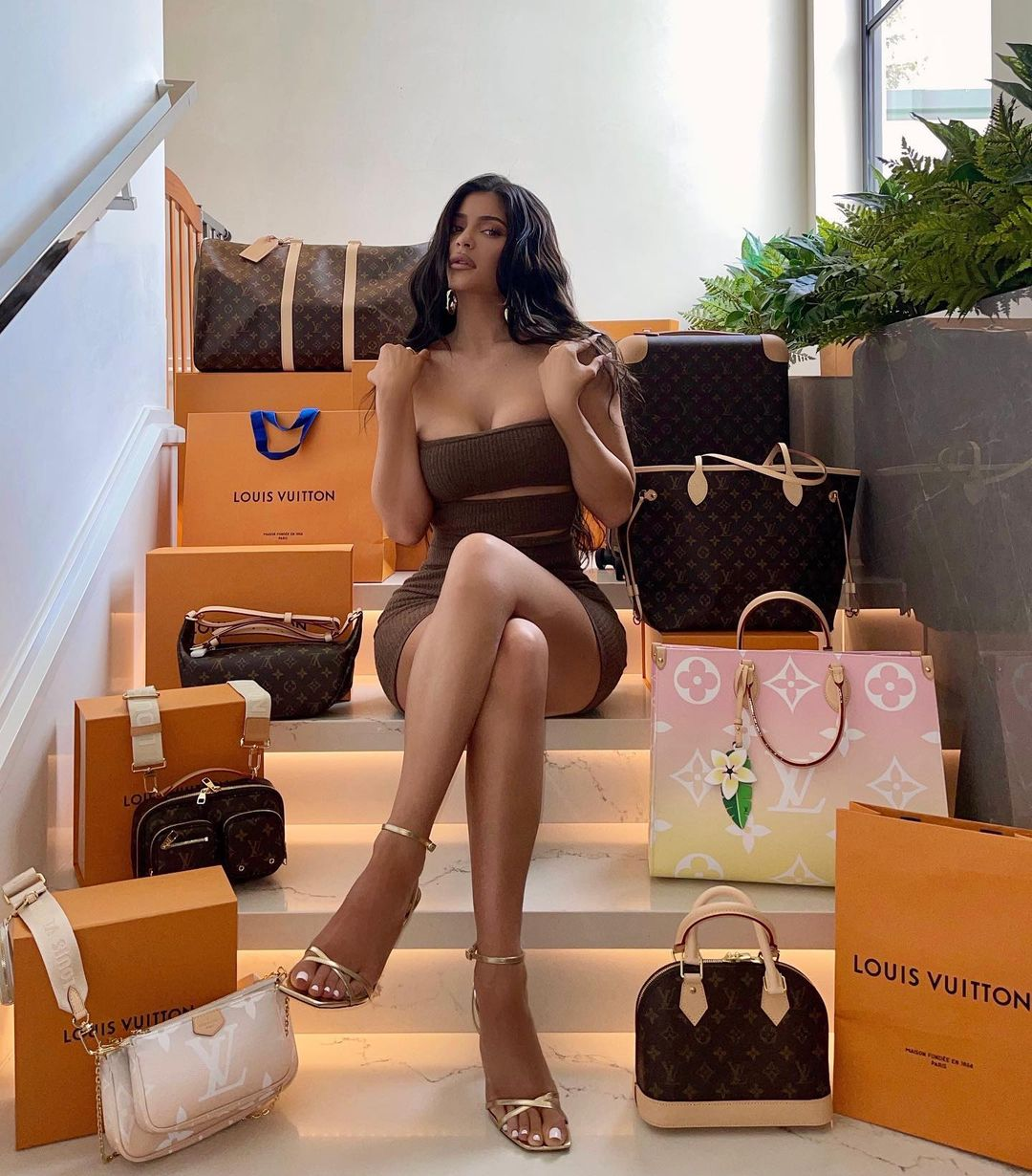 Kylie Jenner wearing square golden ankle sandals with high heel
