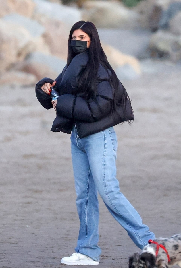 Kylie Jenner wearing round white Nike lace-up sneakers with flat heel