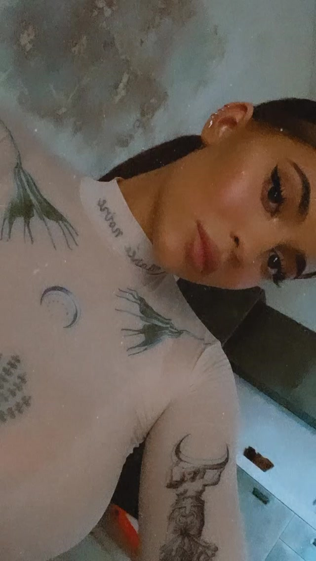 Kylie Jenner donning Sheer off white Marine Serre printed leggings with a see-through fabric