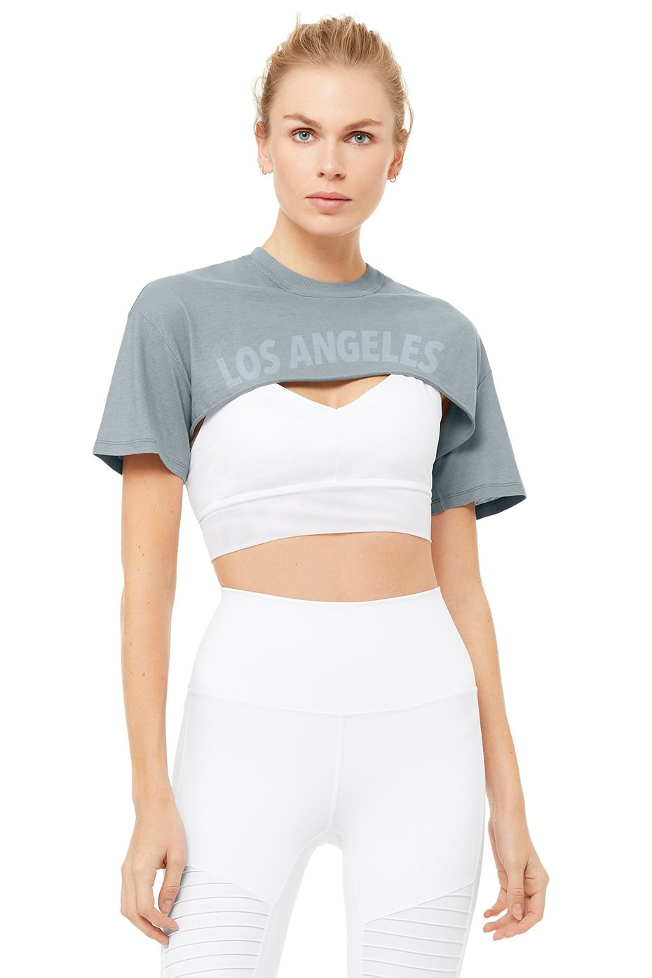 Kylie Jenner donning a Grey Alo Yoga cropped t shirt with short sleeves and a crew neck