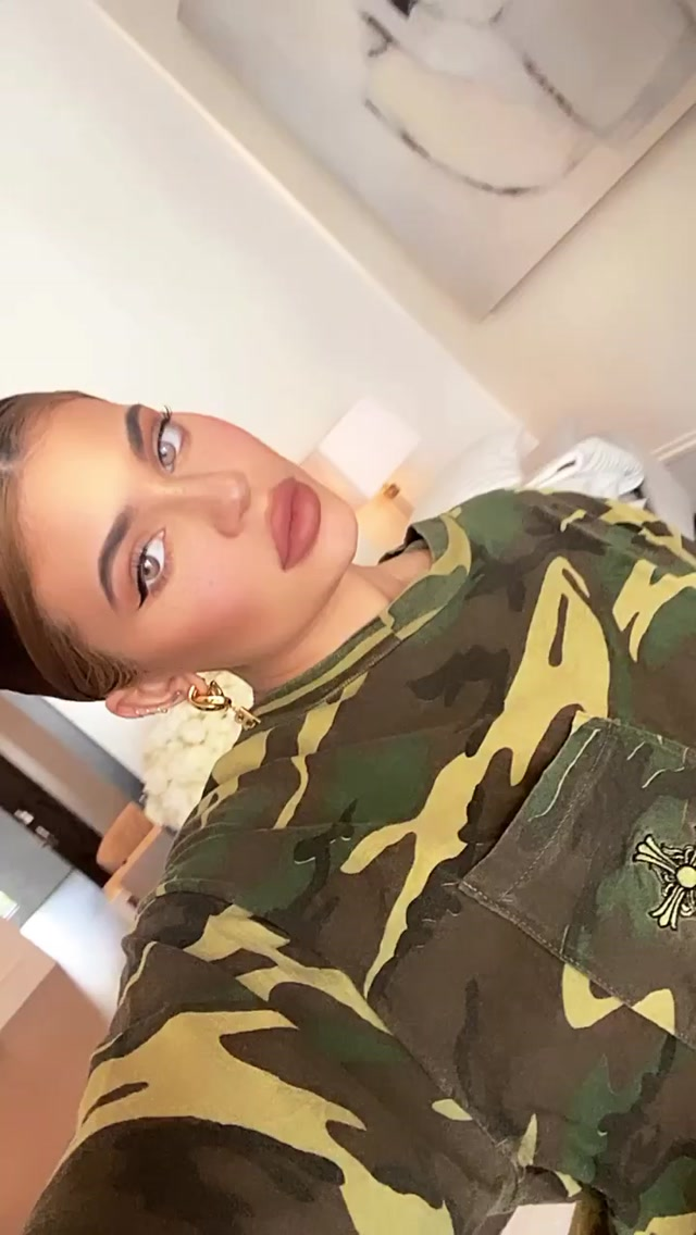 Kylie Jenner, oversized, camo, short sleeves, crew neck, printed, patch pocket, breast pocket, Chrome Hearts cross embroidery. Kylie Jenner wearing a Khakhi Chrome Hearts emboidered camo t shirt with short sleeves and a crew neck