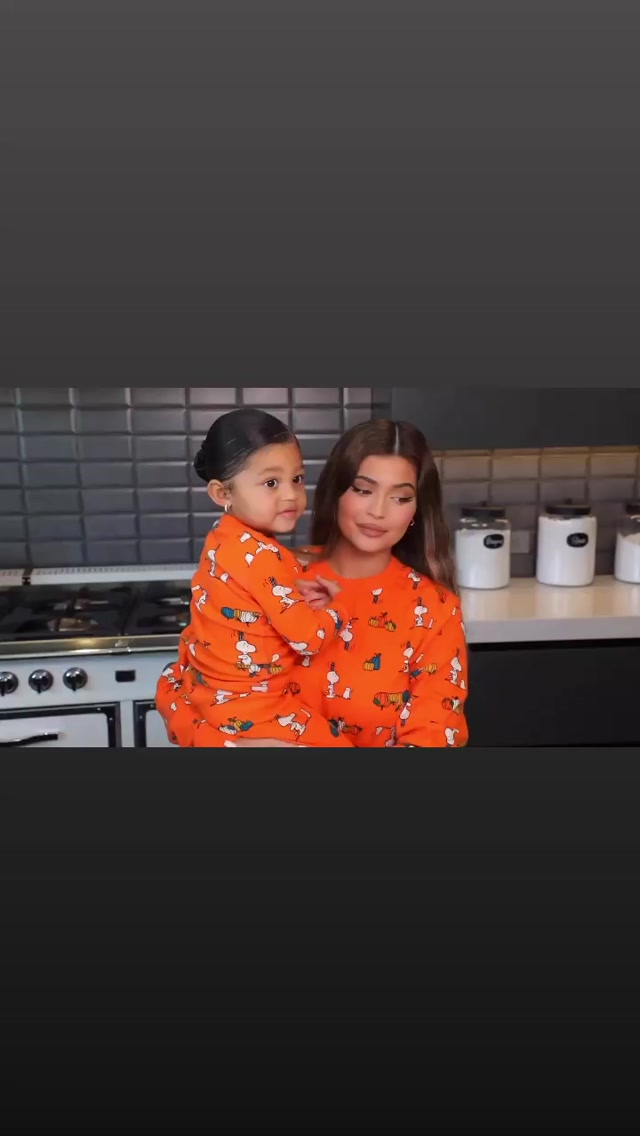 Kylie Jenner rocking a Comfortable striking orange sweatshirt with full sleeves and a crew neck