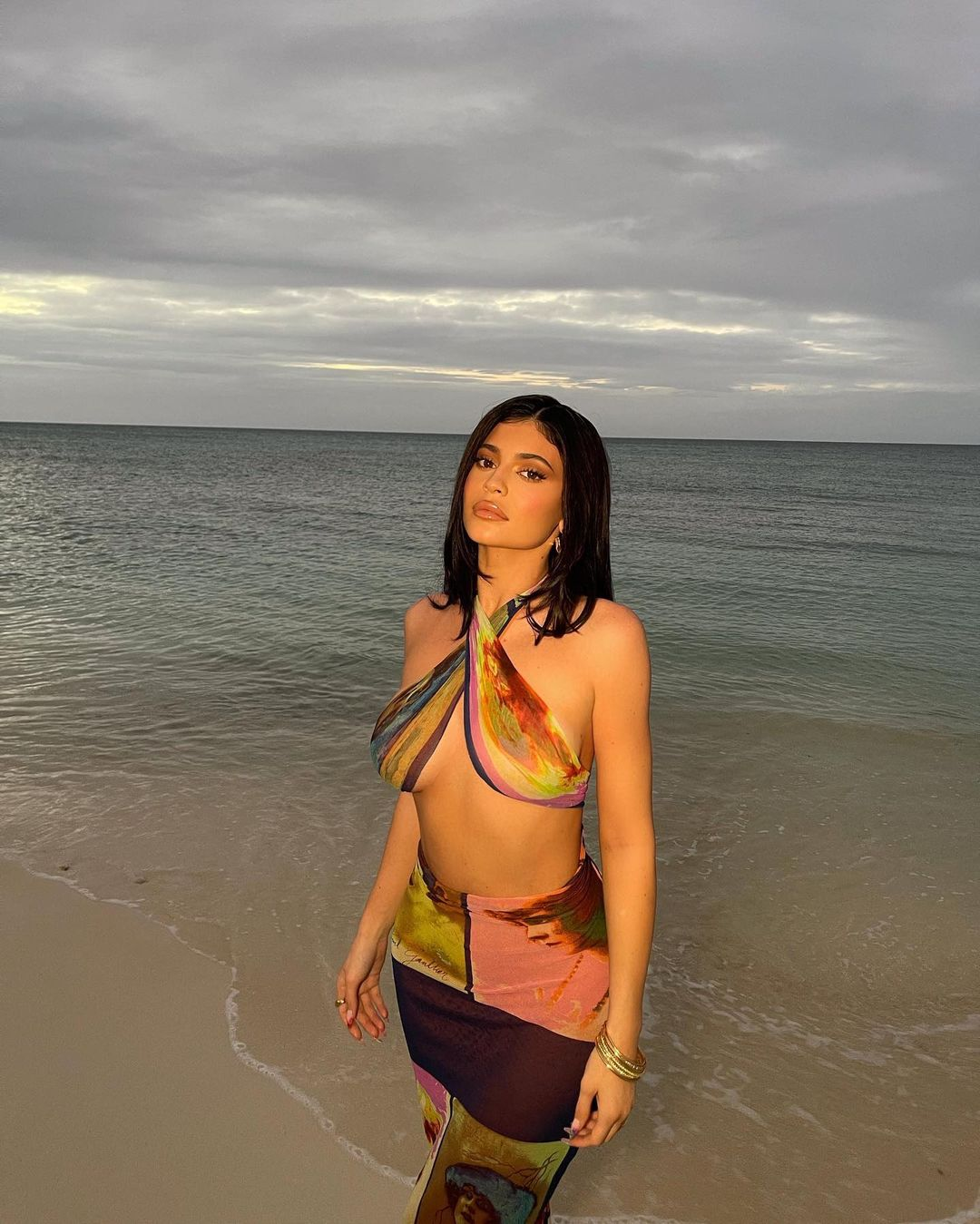 Kylie Jenner donning a figure hugging Jean Paul Gaultier dress with criss cross back and a halter neck