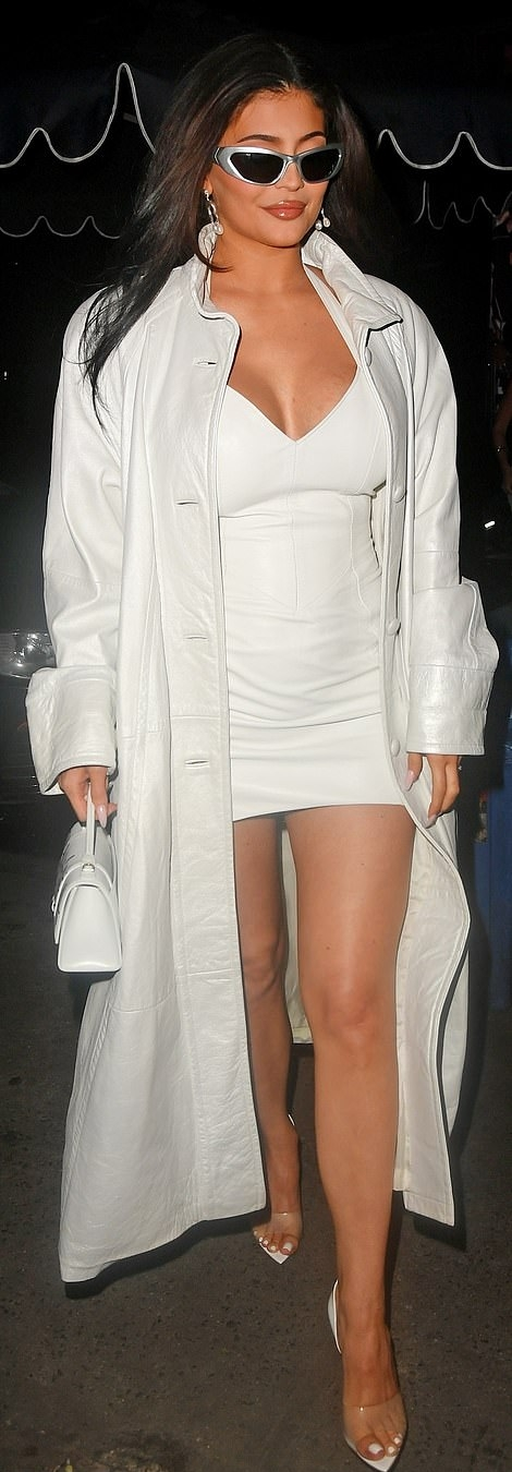 Kylie Jenner rocking sleek white patent-leather open toe sandals by Gianvito Rossi with stiletto heels
