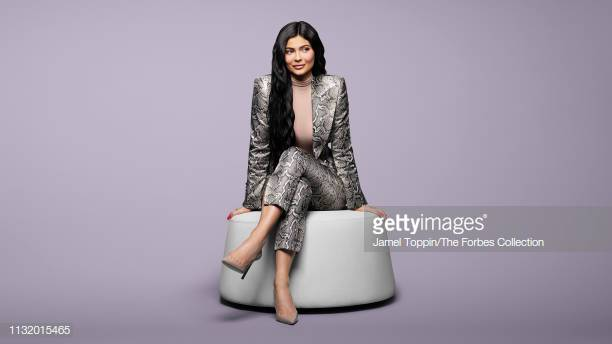 Kylie Jenner rocking a striking grey printed snakeskin blazer with full sleeves, strong shoulder, peak lapel collar and flap pockets