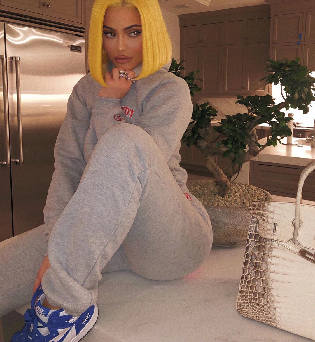 Kylie Jenner rocking pattern blue white lace-up sneakers