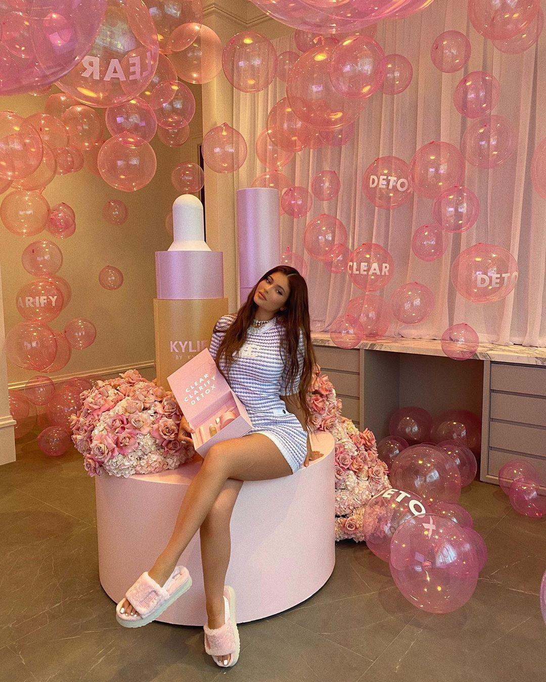 Kylie Jenner rocking chunky light pink open toe sandals with platform heels