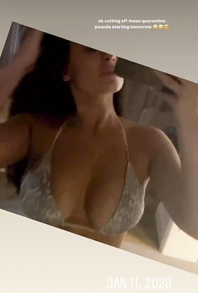 Kylie Jenner wearing Skimpy light grey lace up bikini bottom