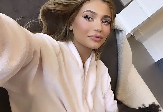 Kylie Jenner wearing a Light pink cosy robe