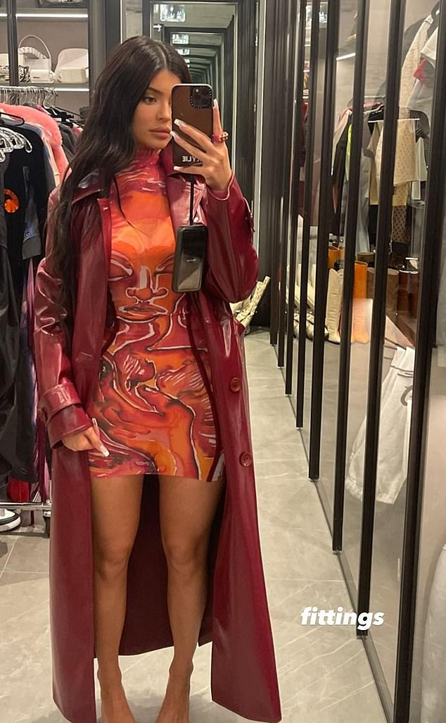 Kylie Jenner rocking a oversized shiny maroon button front leather trench coat with full sleeves, lapel collar and side pockets